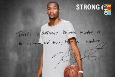 "KIND Healthy Snacks (KIND) and NBA star Kevin Durant unveil movement to show it's strong to be kind(TM). Partnership looks to change perceptions of strength and kindness, and to rally Americans to stand up. ""There's a difference between standing up for my team and trying to be a standout,"" says Durant. (Photo courtesy of KIND Healthy Snacks)"